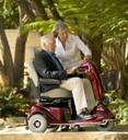 therapist demonstrating electric scooter to client